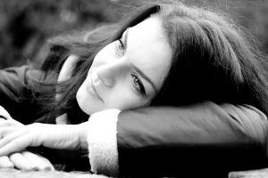 monochrome brunette face women jacket closeup lying down