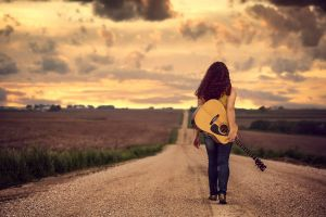 musical instrument road women outdoors jake olson clouds guitar jeans curly hair