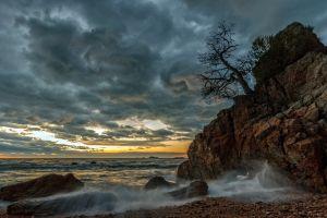 nature sunset clouds rock sea sky shore