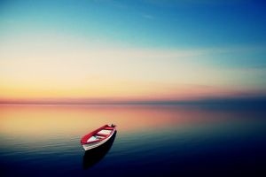 nature yellow boat blue calm sunlight cyan turquoise water vehicle sky sea colorful