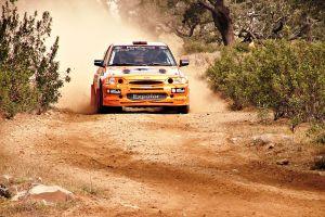 orange cars rally vehicle car escort