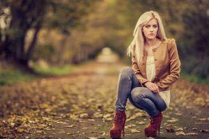 outdoors jeans blonde women fall kneeling leaves women outdoors