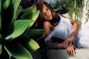 plants looking at viewer singer dark skin leaves long hair white clothing white dress brunette women rihanna lying on side