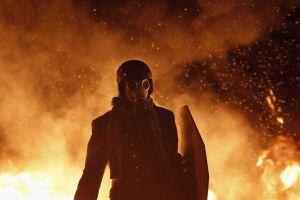 protestors gas masks fire