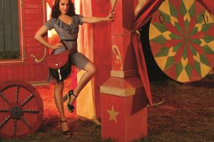 purses striped clothing circus natalia oreiro brunette smiling wheels hands on hips pillar