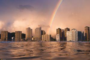 rainbows water city cityscape