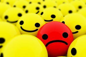 red sad smiley yellow black ball