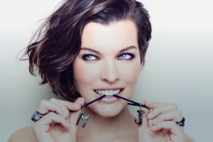 rings milla jovovich  smiling women looking away face actress simple background biting