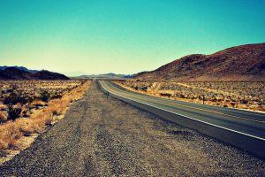 road long road desert landscape hills