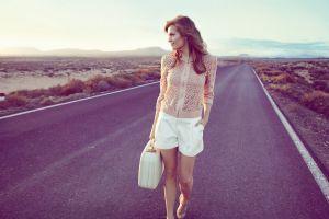 road suitcase looking away landscape women