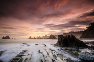 rock nature mist sunlight sky sea landscape
