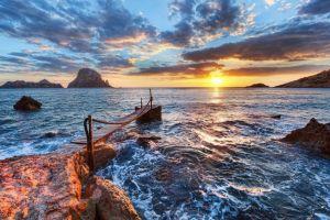 rock nature sky sea sunset