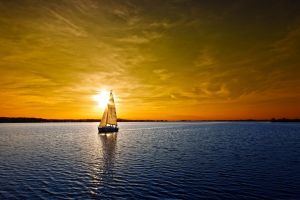 sailboats clouds water landscape sunset sky nature vehicle boat sunlight