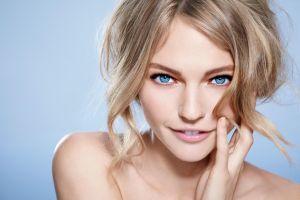 sasha pivovarova women blue eyes face smiling blue background blonde sasha pivovarova blonde closeup blue eyes model portrait simple background