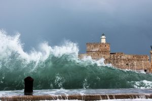 sea shore storm waves building