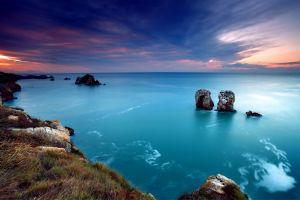sea sunset clouds coast horizon nature turquoise