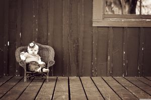 sitting baby sepia chair