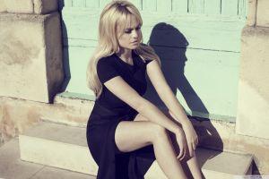 sitting black dress singer women legs blue eyes duffy