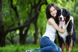 sitting dog women looking at viewer grass animals tongues jeans