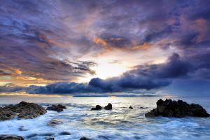 sky clouds cyan coast rock blue sea nature sunset