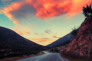 sky clouds landscape shrubs asphalt orange nature road hills