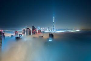 skyscraper night city lights dubai cityscape clouds burj khalifa