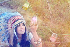 smiling women women outdoors feathers headdress bracelets jars model