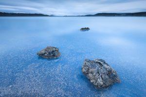 stones cyan landscape water sea