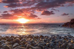 stones horizon sunset sunlight sea beach clouds