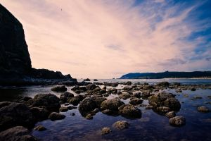 stones sea beach landscape nature