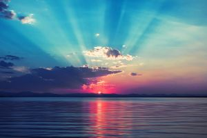 sun sunlight clouds sea pink cyan horizon sunrise calm sky sunset nature water