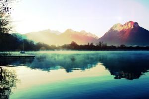 sunlight mist landscape reflection boat lake calm mountains nature water sky pier