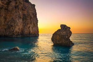sunlight rock cliff nature sea sunset