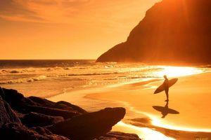 sunlight rock surfers sea beach surfboards