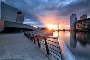 sunlight water cityscape