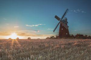 sunrise windmill landscape field sunlight