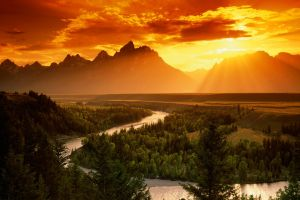 sunset forest trees landscape river pine trees sun rays sunlight orange sky clouds nature mountains