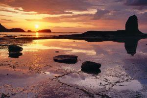 sunset landscape water clouds rock nature beach sky sea