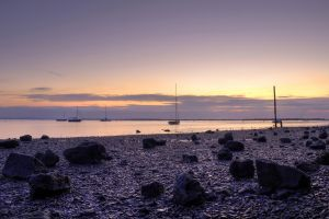 sunset stones beach sky