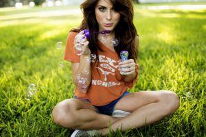 tanit phoenix grass sitting nature bubbles shorts jean shorts women outdoors women brunette