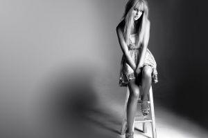 taylor swift singer women monochrome chair celebrity sitting blonde