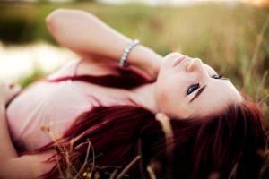 tosha mccarter looking up lying down grass face redhead women