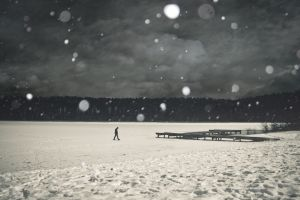 trees ice dark people frozen lake walking pier men solice horizon clouds landscape snow nature alone