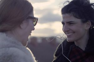 two women smiling brunette women women outdoors short hair