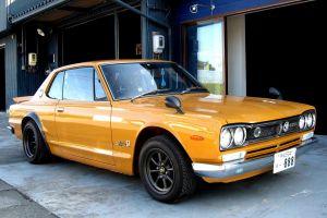 vehicle car orange cars nissan nissan skyline 2000gt