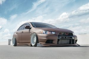 vehicle front angle view evolution chocolate mitsubishi lancer mitsubishi lancer evo x car mitsubishi