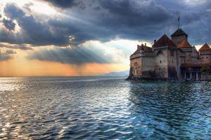 water castle sea waves switzerland clouds sunlight sun rays