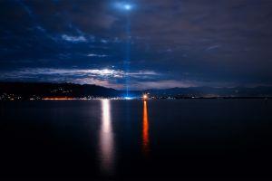 water landscape sea sky night clouds lights