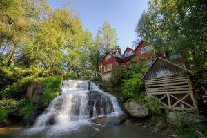 waterfall water sky landscape house