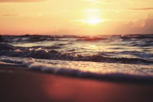 waves water blurred sunrise